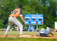 Somerville Central Jersey's Alex Willenbrock #41 awaits a throw to first base before attempting to tag out to tag out North Burlington's Brian Ford in the second inning at North Burlington High School Friday May 29, 2015 in Mansfield, New Jersey. North Burlington defeated Somerville Central Jersey 7-4 to win the Group 3 State Championship. (Photo by William Thomas Cain/Cain Images)