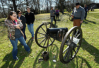 NWA Democrat-Gazette/ANDY SHUPE<br /> Kristin Bro (left) of Prairie Grove checks out a Civil War-era cannon Saturday, March 18, 2017, following a firing demonstration by the 1st Arkansas Mountain Artillery, a local re-enactment group, at Prairie Grove Battlefield State Park in Prairie Grove. The park has an array of programming this week for spring break.