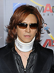 "HOLLYWOOD, CA. - October 19: Yoshiki arrives at the ""Astro Boy"" Los Angeles premiere at Grauman's Chinese Theatre on October 19, 2009 in Los Angeles, California."