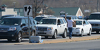 NWA Democrat-Gazette/ANDY SHUPE<br /> Daniel Nelson, a former construction worker originally from Washington, sells bottles of water Thursday, March 15, 2018, at the intersection of Joyce Boulevard and College Avenue in Fayetteville. Nelson, who has struggled with addiction and with drug users at job sites, supports his family by selling water to motorists at the intersection. The Fayetteville City Council is considering adopting an amendment to city code that defines the term &ldquo;roadway&rdquo; as from far curb to far curb. The change aims to promote safety by preventing people from standing in the middle of a road.