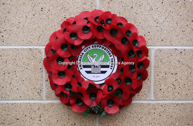 Pictured: A wreath laid under the unveiled plaque Sunday 09 November 2014<br /> Re: Swansea City FC have unveiled a plaque for three former players who died during the First World War commemorating this way Remembrance Sunday. It was unveiled before the Barclays Premier League, Swansea City FC v Arsenal City at the Liberty Stadium, south Wales, UK