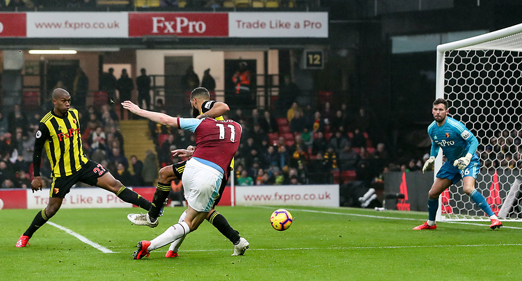 Burnley's Chris Wood shoots at goal as Watford's Ben Foster looks on<br /> <br /> Photographer Andrew Kearns/CameraSport<br /> <br /> The Premier League - Watford v Burnley - Saturday 19 January 2019 - Vicarage Road - Watford<br /> <br /> World Copyright &copy; 2019 CameraSport. All rights reserved. 43 Linden Ave. Countesthorpe. Leicester. England. LE8 5PG - Tel: +44 (0) 116 277 4147 - admin@camerasport.com - www.camerasport.com