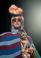 Una modella presenta una creazione di Stella Jean durante la rassegna ITC's Ethical Fashion Initiative con Altaroma a Roma, 7 luglio 2013.<br /> A model wears a creation of Stella Jean during the  ITC's Ethical Fashion Initiative and  Altaroma in Rome, 7 July 2013.<br /> UPDATE IMAGES PRESS/Virginia Farneti