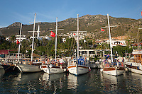 Turkey, Province Antalya, Kalkan: popular resort, Gulets in harbour | Tuerkei, Provinz Antalya, Kalkan: beliebter Ferienort an der Mittelmeerkueste, Ausflugsschiffe (Gulets) im Hafen