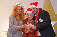Pictured: Nigel Willett (R) with wife Karen (L) from Caerphilly and a guest. Wednesday 28 November 2018<br /> Re: National Lottery millionaires from south Wales and the south west of England have hosted a glitzy Rat Pack-inspired Christmas party for an older people's music group at The Bear Hotel in Cowbridge, Wales, UK.