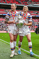 Picture by Alex Whitehead/SWpix.com - 29/08/2015 - Rugby League - Ladbrokes Challenge Cup Final - Hull KR v Leeds Rhinos - Wembley Stadium, London, England - Leeds' Kevin Sinfield and Jamie Peacock celebrate with the trophy.