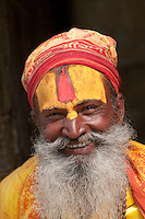 Pashupatinath Temple, Nepal.  Sadhu, a Hindu Ascetic or Holy Man.  The stylized trident he wears on his forehead identifies him as a devotee of Shiva.