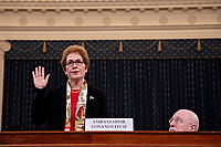 "Marie Yovanovitch, former U.S. Ambassador to Ukraine, swears in to a House Intelligence Committee impeachment inquiry hearing in Washington, D.C., U.S., on Friday, Nov. 15, 2019. Yovanovitch testified in private on October 11 that she was called back to Washington after a ""concerted campaign"" by President Trump and his allies, including Rudy Giuliani, according to a transcript released later. <br /> Credit: Andrew Harrer / Pool via CNP/AdMedia"