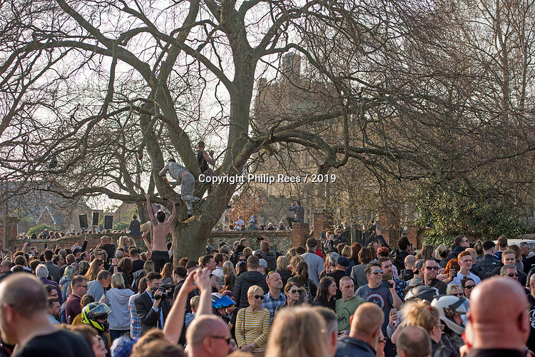 Prodigy fans climb a tree to watch and listen to the service during the funeral of Prodigy singer Keith Flint at St Marys Church in Bocking,  Essex today.