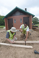 NWA Democrat-Gazette/FLIP PUTTHOFF <br />TRAILSIDE REST STOP<br />Brett Blockhus (left) and Xendy Tatibouet work on a restroom building along the Razorback Greenway in Bentonville. The restroom is one-quarter mile east of the Slaughter Pen Mountain Bike Trail entrance in north Bentonville. The two were building forms in preparation for concrete pouring set for Thursday.