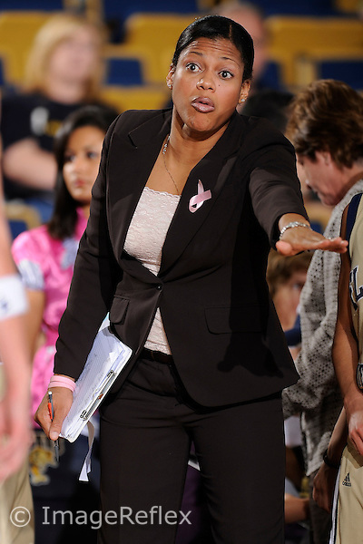 28 February 2009:  FIU Assistant Coach Desma Thomas Bateast signals to her players during the Florida Atlantic University 57-48 victory over FIU at the U.S. Century Bank Arena in Miami, Florida.