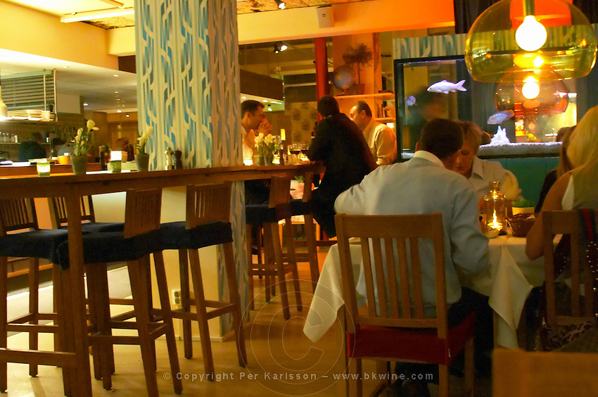 Restaurant 'Grill' run by the famous chef Melker Andersson. people at tables. Stockholm. Sweden, Europe.