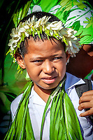 A young boy adorned with traditional adornments at investiture of Makirau Haurua with the Teurukura Ariki title, Aitutaki Island, Cook Islands.