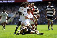 Kyle Eastmond of England is congratulated by Marland Yarde (left) and Haydn Thomas (centre) after scoring on his debut during the match between England and Barbarians at Twickenham on Sunday 26th May 2013 (Photo by Rob Munro)