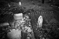 "Nagorny-Karabach, 22.05.2011, Shushi. Ein alter und verw¸steter aserischer Friedhof f¸r Muslime am Stadtrand. ""The Twentieth Spring"" - ein Portrait der s¸dkaukasischen Stadt Schuschi, 20 Jahre nach der Eroberung der Stadt durch armenische K?mpfer 1992 im B¸gerkrieg um die Unabh?ngigkeit Nagorny-Karabachs (1991-1994). Old and ruined aseri (muslim) cemetery in Shushi. ..""The Twentieth Spring"" - A portrait of Shushi, a south caucasian town 20 years after its ""Liberation"" by armenian fighters during the civil war for independence of Nagorny-Karabakh (1991-1994). .Un vieux cimetière aséri (musulman) en ruine à Chouchi. ""Le Vingtieme Anniversaire"" - Un portrait de Chouchi, une ville du Caucase du Sud 20 ans après sa «libération» par les combattants arméniens pendant la guerre civile pour l'indépendance du Haut-Karabakh (1991-1994)..© Timo Vogt/Est&Ost, NO MODEL RELEASE !!"