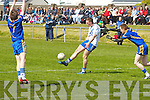 The second half was all St Mary's coming from 5 points behind to taking a 2 point lead the home side had the advantage pictured here Paul O'Donoghue breaking from the challenge of Spa's Mathew Moynihan and the attempted block from Eoin Cronin slots this great point over the bar for the home side.