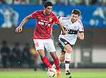 (L) Paulinho of Guangzhou Evergrande being followed by (R) Xabi Alonso of Bayern Munich during the Bayern Munich vs Guangzhou Evergrande as part of the Bayern Munich Asian Tour 2015  at the Tianhe Sport Centre on 23 July 2015 in Guangzhou, China. Photo by Aitor Alcalde / Power Sport Images