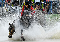 LEXINGTON, KENTUCKY - APRIL 29: Irish Rhythm #40, with rider Rachel McDonough (CAN), make a splash as they reach the Head of the Lake during the Cross Country Test at the Rolex Kentucky 3-Day Event at the Kentucky Horse Park on April 29, 2017 in Lexington, Kentucky. (Photo by Scott Serio/Eclipse Sportswire/Getty Images)
