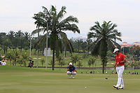 Rafa Cabrera Bello (Europe) and Gavin Green (Asia) on the 14th green during the Singles Matches of the Eurasia Cup at Glenmarie Golf and Country Club on the Sunday 14th January 2018.<br /> Picture:  Thos Caffrey / www.golffile.ie