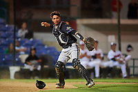 Missoula Osprey catcher Axel Andueza (14) throws to first base during a Pioneer League game against the Great Falls Voyagers at Centene Stadium at Legion Park on August 19, 2019 in Great Falls, Montana. Missoula defeated Great Falls 1-0 in the second game of a doubleheader. (Zachary Lucy/Four Seam Images)