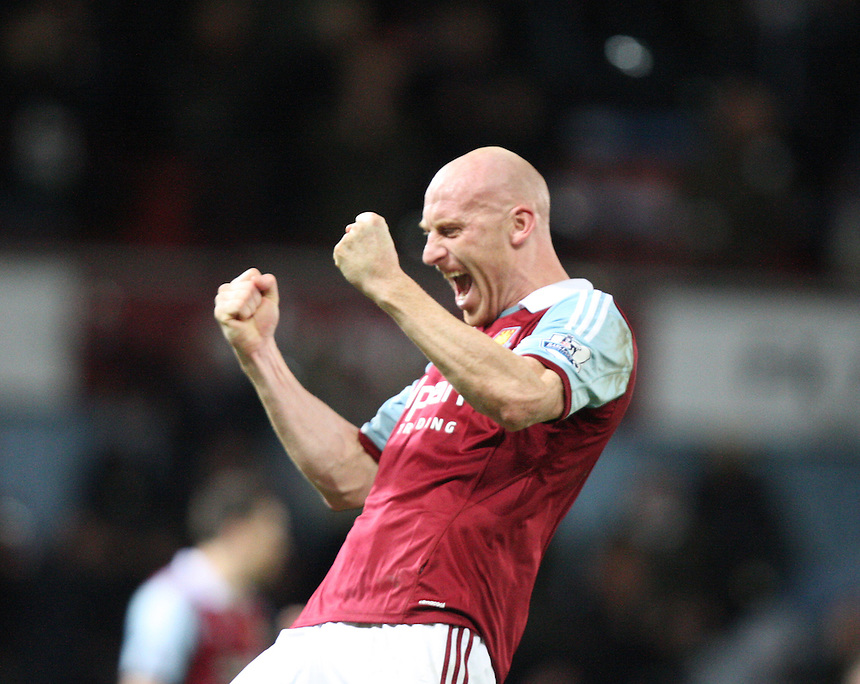 West Ham United's James Collins celebrates they win<br /> <br /> Photo by Kieran Galvin/CameraSport<br /> <br /> Football - Barclays Premiership - West Ham United v Norwich City - Tuesday 11th February 2014 - Boleyn Ground - London<br /> <br /> &copy; CameraSport - 43 Linden Ave. Countesthorpe. Leicester. England. LE8 5PG - Tel: +44 (0) 116 277 4147 - admin@camerasport.com - www.camerasport.com
