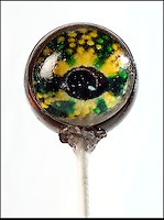 BNPS.co.uk (01202 558833).Pic: RachelAdams/BNPS..Chameleon...Not for the feint hearted.....A house wife has invented a creepy range of eye-popping lollies from a menagerie of cold blooded creatures that might not be to everyone's taste...Priscilla Briggs reptilliain creations are now slithering off the shelves as sweet toothed lollipot lovers from all over the world check out her booming website...Lizard lover Priscilla decided to try her hand at creating the unusual confectionery and mixed sugar with isomalt and corn syrup in a hot pan before pouring it into moulds...Priscilla let the sugary liquid set in two halves, and placed a circular image of a creepy eye over one of the segments...She then placed the two pieces together and waited for them to harden to give the effect of three-dimensional animal eyes...Her first batch of delicious home-made treats received good feedback and as she refined her skills the mother-of-three came up with more unusual ideas and designs...Priscilla, 32, has now produced a batch of 12 brightly coloured,  eyeball themed lollipops that wouldn't look out of place on a chameleon, python, or boa constrictor..
