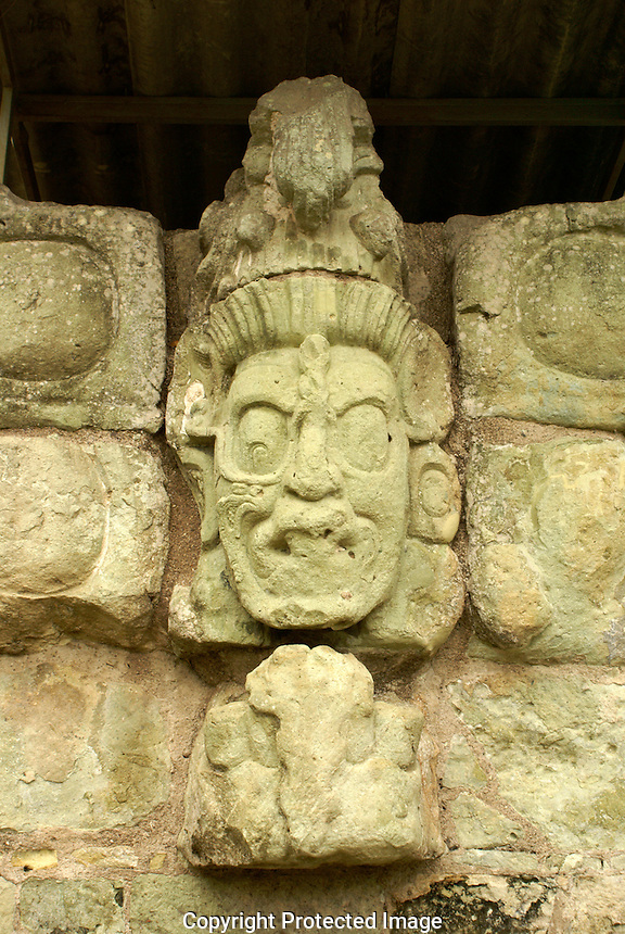 Sculpted face on the Acropolis at at the Mayan ruins of Copan, Honduras. Copan is a UNESCO World Heritage Site.