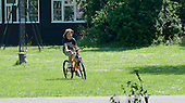 Cycling in the grounds, Summerhill School, Leiston, Suffolk. The school was founded by A.S.Neill in 1921 and is run on democratic lines with each person, adult or child, having an equal say.  You don't have to go to lessons if you don't want to but could play all day.  It gets above average GCSE exam results.