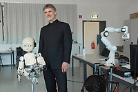 "Switzerland. Canton Ticino. Manno. IDSIA. Robot lab. Jürgen Schmidhuber (born 17 January 1963) is a computer scientist most noted for his work in the field of artificial intelligence, deep learning and artificial neural networks. He is a co-director of the Dalle Molle Institute for Artificial Intelligence Research in Manno. The native german Bavarian is sometimes called the ""father of (modern) AI"" or, the ""father of deep learning"". He stands close to the robot iCub. iCub is a 1 metre tall open source robotics humanoid robot testbed for research into human cognition and artificial intelligence. The Dalle Molle Institute for Artificial Intelligence Research (Italian: Istituto Dalle Molle di Studi sull'Intelligenza Artificiale, IDSIA) is a research institution in Manno. It was founded in 1988 by Angelo Dalle Molle through the private Fondation Dalle Molle. In 2000 it became a public research institute, affiliated with the University of Lugano and SUPSI in Ticino, Switzerland. In 1997 it was listed among the top ten artificial intelligence laboratories, and among the top four in the field of biologically-inspired AI. In 2007 a robotics lab with focus on intelligent and learning robots, especially in the fields of swarm and humanoid robotics, was established. Manno is a municipality in the district of Lugano. 8.05.2020 © 2020 Didier Ruef"