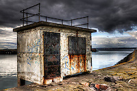 Small hut on the Granton Harbour, Edinburgh, Scotland..This is one of two such structures on the long East breakwater (over 3000 ft - 1000 meters). The Middle Pier (1700ft long) can be seen on the background..Granton Harbour dates from the 1830's with the East breakwater being finished in 1863..Granton Harbour was once home for a large fishing fleet and the destination for ferries across the Firth of Forth. Now it is mainly used by yachts from the Royal Forth Yacht Club..Due to its length, going deep into the Firth of Forth, the East Breakwater is also a popular location for amateur fishermen.