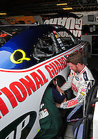 May 2, 2008; Richmond, VA, USA; NASCAR Sprint Cup Series driver Dale Earnhardt Jr helps crew members work on his car during practice for the Dan Lowry 400 at the Richmond International Raceway. Mandatory Credit: Mark J. Rebilas-US PRESSWIRE