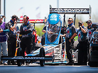 Apr 14, 2019; Baytown, TX, USA; Crew members stand alongside the dragster of NHRA top fuel driver Antron Brown during the Springnationals at Houston Raceway Park. Mandatory Credit: Mark J. Rebilas-USA TODAY Sports