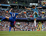 Leroy Sane of Manchester City leaps up to attempt a volley past Danny Simpson of Leicester City during the English Premier League match at the Etihad Stadium, Manchester. Picture date: May 13th 2017. Pic credit should read: Simon Bellis/Sportimage