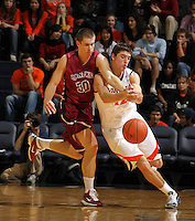 Nov 6, 2010; Charlottesville, VA, USA; Roanoke College f Dylan Berry (30) fights for the loose ball with Virginia Cavaliers g Joe Harris (12) Saturday afternoon in exhibition action at John Paul Jones Arena. The Virginia men's basketball team recorded an 82-50 victory over Roanoke College.