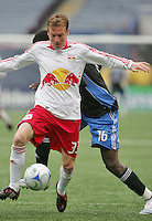 New York Red Bulls' Chris Leitch (33) moves the ball in front of San Jose Earthquakes' Kei Kamara (16) in the first half of an MLS soccer match at Giants Stadium in East Rutherford, N.J. on Sunday, April 27, 2008. The Red Bulls defeated the Earthquakes 2-0.