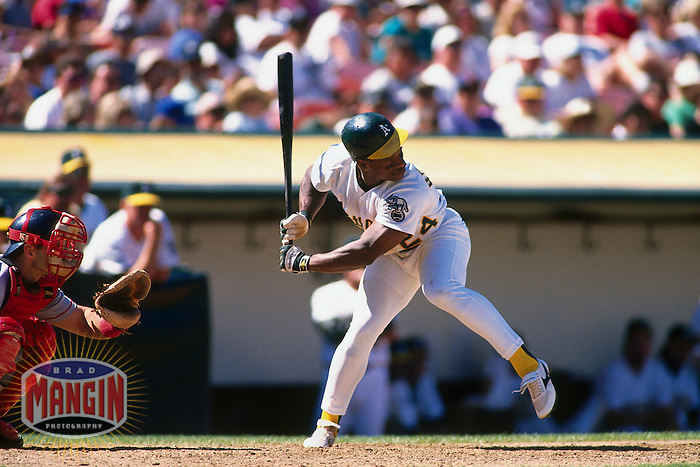 OAKLAND, CA - Rickey Henderson of the Oakland Athletics in action during a game at the Oakland Coliseum in Oakland, California in 1995. Photo by Brad Mangin