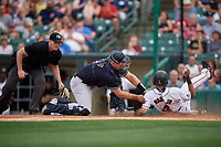 Scranton/Wilkes-Barre RailRiders catcher Erik Kratz (47) swipes the tag as LaMonte Wade (4) slides home safely with umpire Richard Riley looking on during an International League game against the Rochester Red Wings on June 24, 2019 at Frontier Field in Rochester, New York.  Rochester defeated Scranton 8-6.  (Mike Janes/Four Seam Images)