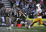 Nevada's Kendall Brock (20) runs into the end zone followed by Wyoming's Darrenn White (13) during the first half of an NCAA college football game in Reno, Nev., on Saturday, Oct. 6, 2012. (AP Photo/Cathleen Allison)