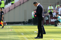 Swansea City manager Paul Clement makes notes during the Premier League match between West Ham United and Swansea City at the London Stadium, England, UK. 08 April 2017