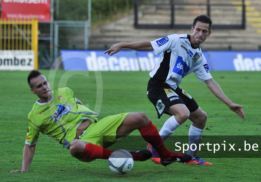 KSV Roeselare - White Star Woluwe : Benjamin Lutun in duel om de bal met Maxime Chanot.foto VDB / BART VANDENBROUCKE