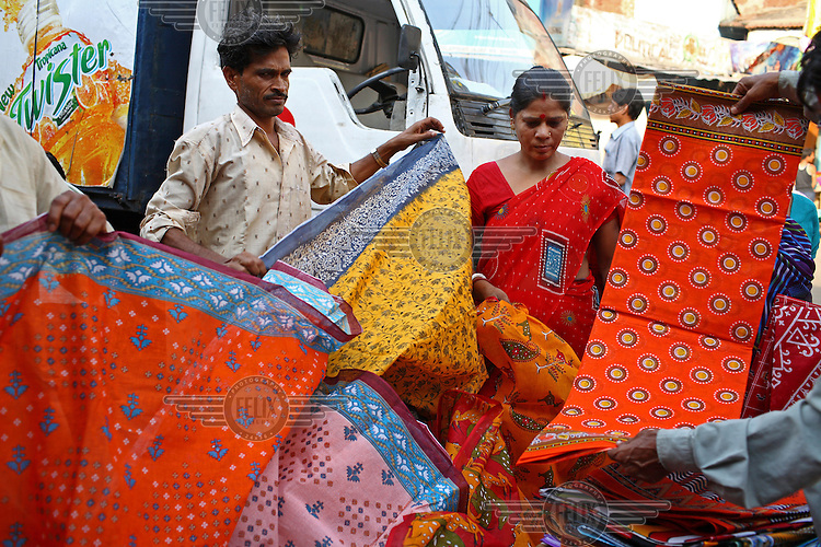 People buying fabric from a street vendor in Kolkata..