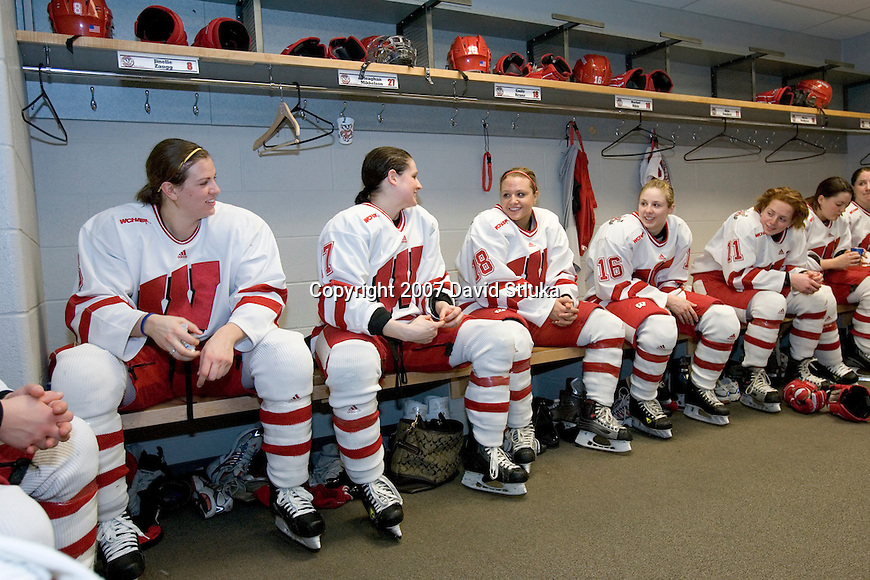 MADISON, WI - FEBRUARY 11: The Wisconsin Badgers women's hockey team rest between the 1st and 2nd periods against the Ohio State Buckeyes at the Kohl Center on February 11, 2007 in Madison, Wisconsin. The Badgers beat the Buckeyes 3-2. (Photo by David Stluka)