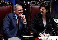 Il Presidente del Senato Piero Grasso parla col Presidente della Camera Laura Boldrini durante la seduta comune di senatori e deputati per l'elezione del nuovo Capo dello Stato alla Camera dei Deputati, Roma, 18 aprile 2013..Italian Senate President Pietro Grasso, left, talks to Lower Chamber President Laura Boldrini during the common plenary session of senators and deputies to elect the new Head of State, at the Lower Chamber in Rome, 18 April 2013..UPDATE IMAGES PRESS/Riccardo De Luca.