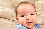 2 month old baby boy, closeup portrait smiling