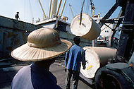 October 1984. On Shanghai piers all kind of goods made in China are exported. Here electric equipment, steel, and cables.