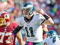 Philadelphia Eagles quarterback Carson Wentz (11) calls an audible in fourth quarter action against the Washington Redskins at FedEx Field in Landover, Maryland on Sunday, October 16, 2016. The Redskins won the game 27 - 20.<br /> Credit: Ron Sachs / CNP /MediaPunch