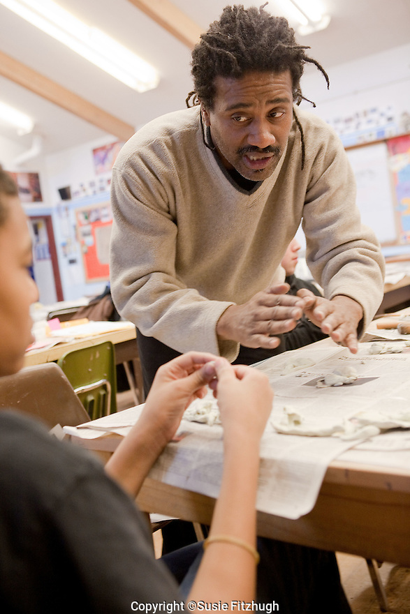 Arts Corps teacher Brent McDonald works with his Visual Arts students at Meany Middle School.