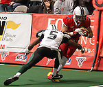 SIOUX FALLS, SD - FEBRUARY 26:  Lorenzo Brown #13 from the Sioux Falls Storm gets a first down past James Romain #5 from the Green Bay Blizzard in the second quarter of their game Sunday afternoon at the Sioux Falls Arena. (Photo by Dave Eggen/Inertia)