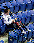 Connor Hardowa (UNH - 2) watches the end of a kids' game on the ice. - The University of New Hampshire Wildcats visited the University of Massachusetts-Lowell River Hawks at Tsongas Arena in Lowell, Massachusetts, on Thursday, December 2, 2010.