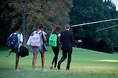 United States President Barack Obama and daughters Malia Obama, second from right, Sasha Obama, third from right, and an unidentified guest walk out of the White House with daughter Malia Obama to board Marine One on the South Lawn in Washington, D.C., U.S., on Friday, Sept. 19, 2014. The First Family is traveling to Camp David for the weekend and is expected to return to the White House on Sunday, Sept. 21. <br /> Credit: Andrew Harrer / Pool via CNP